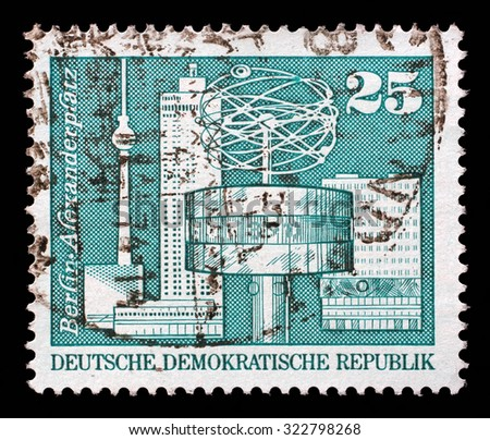 GDR - CIRCA 1973: a stamp printed in GDR shows World Clock, Alexander Square, Berlin, circa 1973 - stock photo
