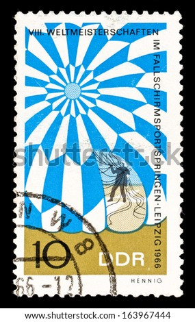 GDR- Circa 1966: GDR stamp dedicated to the World Championship in parachute jumping in Leipzig, circa 1966. - stock photo