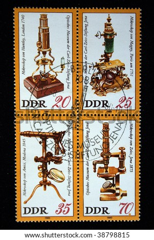 GDR - CIRCA 1980: Stamps printed in GDR (East Germany) shows vintage microscopes, circa 1980