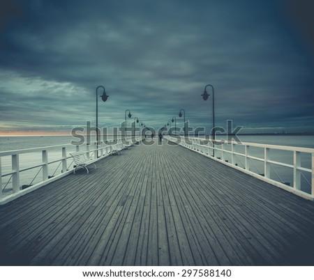 Gdynia Orlowo pier. Vintage photo of Baltic sea shore seascape. - stock photo