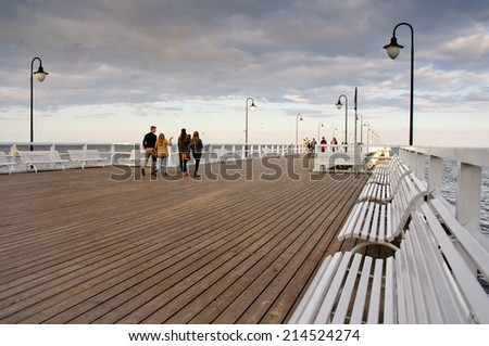 GDYNIA ORLOWO, POLAND - JUNE 16: Crowd people on the pier. June 16, 2014. Gdynia Orlowo, Poland. - stock photo