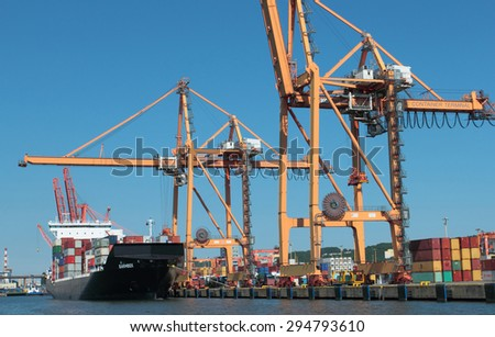 GDYNIA, POLAND - JUNE 13, 2015: Container terminal port with laded ship on pier in Gdynia, Poland