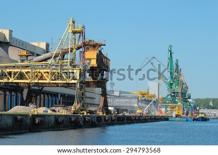 GDYNIA, POLAND - JUNE 13, 2015: Port of Gdynia with ships and cranes on pier, Poland - stock photo