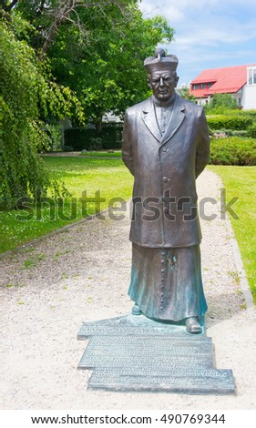 GDYNIA, POLAND - JUNE 15, 2014: Statue of a famous holy person at a park on a sunny day