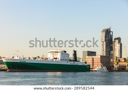 GDYNIA, POLAND - JUNY 13: Sea Towers skyscraper and cargo ship Antares on Juny 13, 2015, Poland.