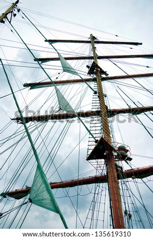 Gear old sailing ship on the background of an blue sky