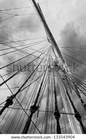 Gear old sailing ship on the background of an overcast sky - Turku, Finland (black and white) - stock photo