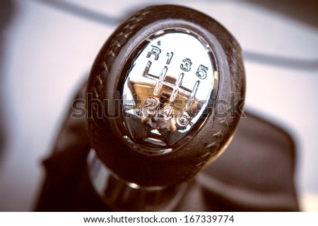 Gear shift handle in a modern car - stock photo