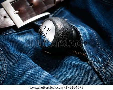 Gear shift lever in the zipper of men's jeans.