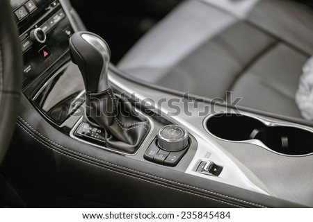 Gear stick with multimedia console - stock photo