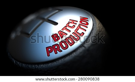 Gear Stick with Red Text Batch Production on Black Background. Selective Focus. 3D Render. - stock photo
