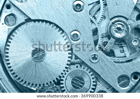 Gear wheels inside clock. Concept Teamwork , Idea Technology. Macro