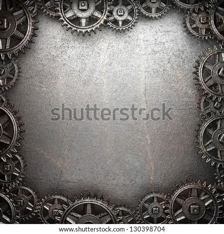 gear wheels on steel background - stock photo