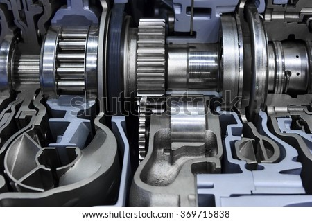 Gearbox cross-section, engine industry, sprockets, cogwheels and bearings of automotive transmission for oversize trucks, SUV, cargo, commercial and construction vehicles, selective focus  - stock photo