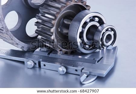 gears and bearings with calipers on a metal plate