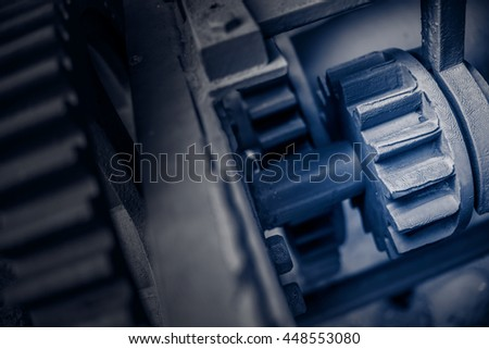 Gears and cogs, red toned - stock photo