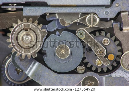 Gears and levers inside vintage mechanical camera