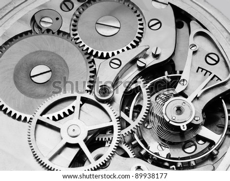 gears and mainspring in the mechanism of a pocket watch (pocketwatch) - stock photo