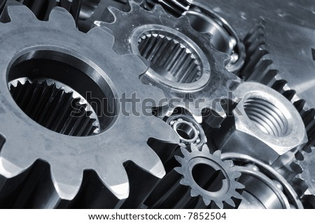 gears, bearings and bolts in bluish toning against steel background