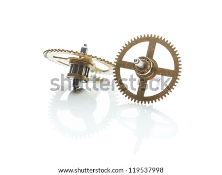 gears from old clock isolated on white background with reflection - stock photo