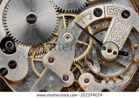 gears of a vintage clock machinery, close up - stock photo