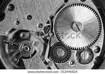 Gears old mechanical watches. Pendulum, cogs under the hood. Close up view, selective focus. Black and white toning. - stock photo