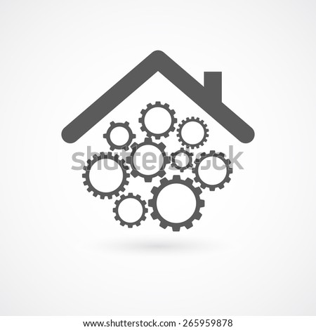 gears wheel cogs under home roof concept - stock photo