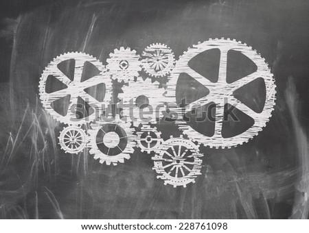Gears with chalk on blackboard background - stock photo
