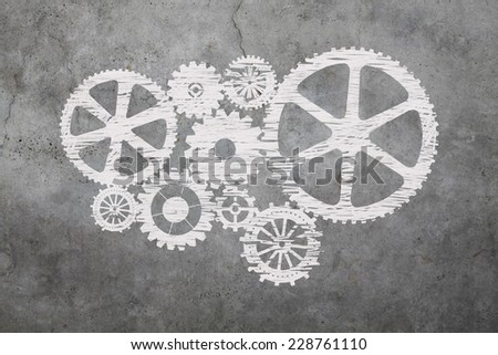 Gears with chalk on cement background - stock photo
