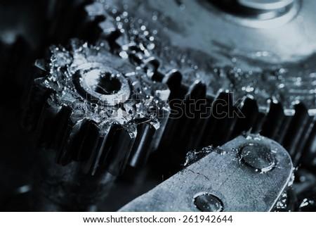 Gears work in an industrial machine - stock photo