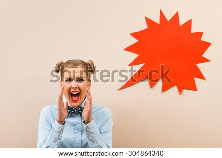Geek girl is very angry because of something.Angry geek girl - stock photo