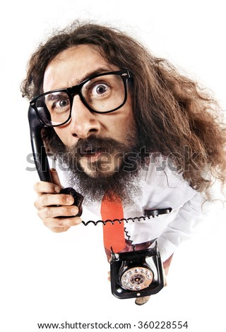 Geeky businessman making a phone call - stock photo