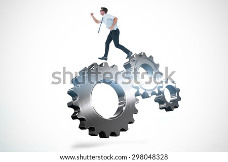 Geeky businessman running late against metal cog and wheel connecting - stock photo