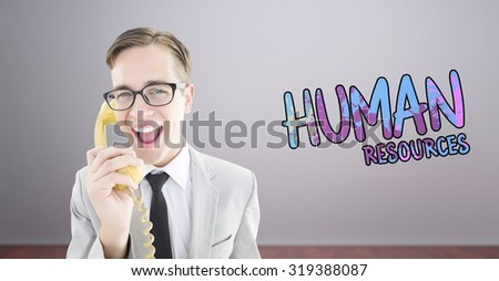 Geeky businessman talking on retro phone against room with wooden floor