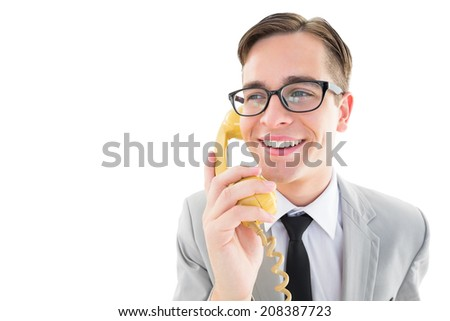 Geeky businessman talking on retro phone on white background
