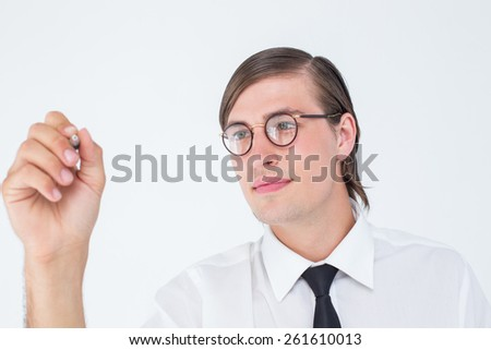 Geeky businessman writing with pen on white background