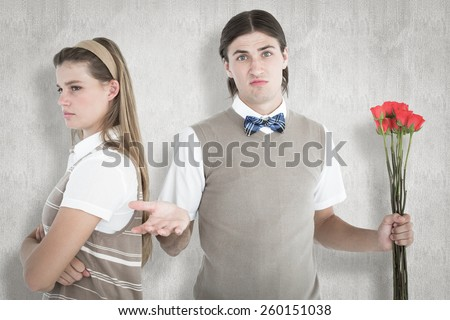 Geeky hipster couple not talking after argument against white background - stock photo