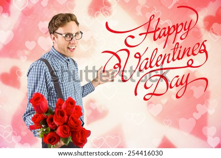 Geeky hipster holding a bunch of roses against valentines heart design - stock photo