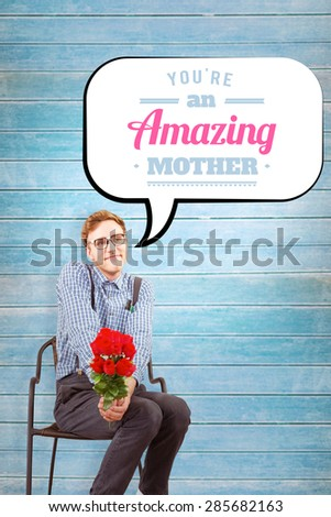 Geeky hipster holding a bunch of roses against wooden planks background