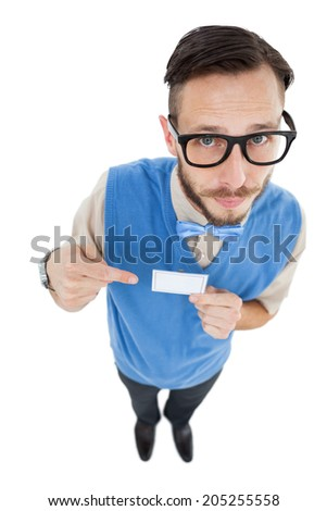 Geeky hipster looking at camera pointing at card on white background