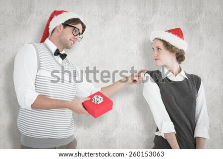Geeky hipster offering present to his girlfriend against white background