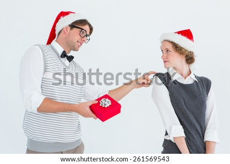 Geeky hipster offering present to his girlfriend on white background