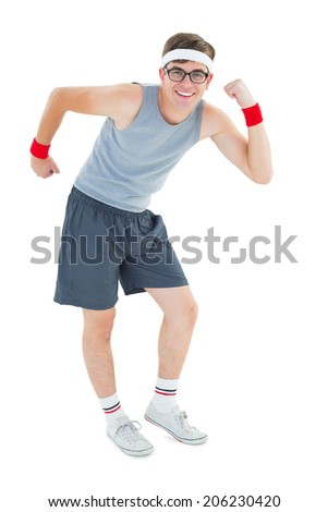 Geeky hipster posing in sportswear on white background - stock photo