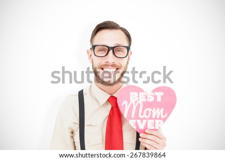 Geeky hipster smiling and holding heart card against best mom ever - stock photo