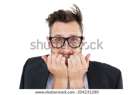 Geeky nervous businessman looking at camera on white background - stock photo