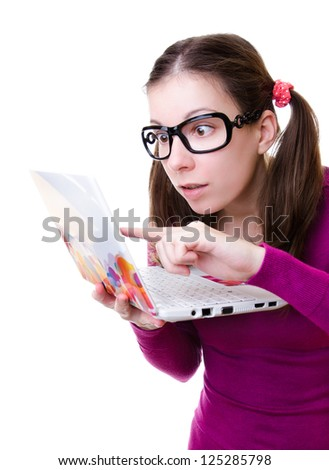 Geeky woman with a laptop isolated on white - stock photo