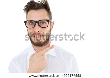 Geeky young businessman looking at camera and pointing on white background - stock photo
