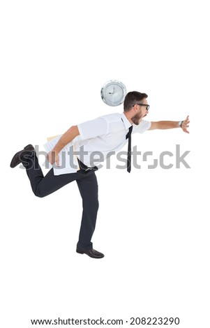 Geeky young businessman running late on white background - stock photo