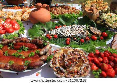 gefilte fish with grilled meat sausages - stock photo