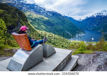 Geiranger fjord observation deck, Beautiful Nature Norway. It is a 15-kilometre (9.3 mi) long branch off of the Sunnylvsfjorden, which is a branch off of the Storfjorden (Great Fjord). - stock photo
